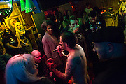 October 2013 - New York, NY. -  Otto's Shrunken Head. Chad Afterbirth works the crowd in Otto's backroom.  - Photograph by Jeanette D. Moses/CUNY Journalism Photo