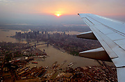 A view of Manhattan from a plane preparing to land at La Guardia airport in Queens, New York.