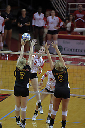 31 Aug 2010: Katie Culbertson sends the ball towards Karen Sueppel and Mallory Curran. The Illinois State Redbirds trumped the Rambles of Loyola-Chicago 3 sets to none at Redbird Arena on the campus of Illinois State University in Normal Illinois.