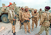 Saudi Arabian soldiers prepare to load into armored personnel carriers during clean up operations following the Battle of Khafji February 2, 1991 in Khafji City, Saudi Arabia. The Battle of Khafji was the first major ground engagement of the Gulf War.