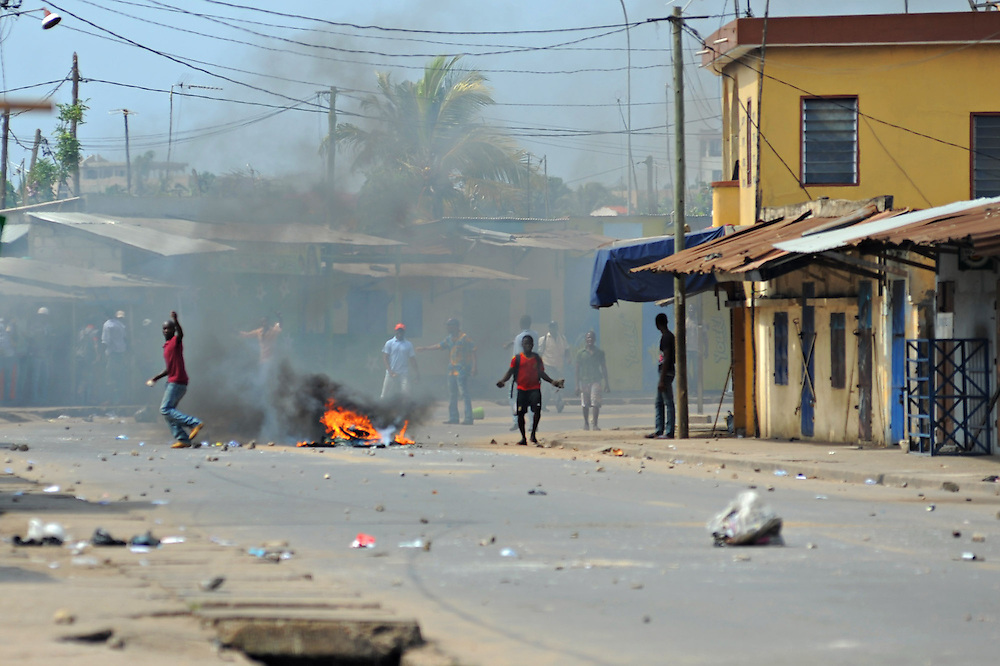 LOME, TOGO - 12-10-05   - Protesters taunt police as they clash in the Lomé neighbourhood of Bé. Protesters clashed with police in Lomé on October 5. A peaceful protest was scheduled by opposition groups, but their route was blocked by police.  For months, opposition parties have been calling for the departure of president Faure Gnassingbe, whose family has been in power for over 40 years.   Photo by Daniel Hayduk
