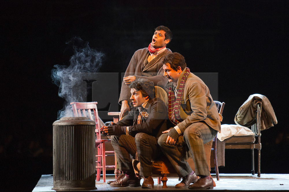 © Licensed to London News Pictures. 26 February 2014. London, England. L-R: Joshua Bloom as Colline, Sean Panikkar as Rodolfo and Michael Chioldi as Marcello. LA BOHÈME, Giacomo Puccini's masterpiece of doomed love and tragic passion, will play fourteen performances at the Royal Albert Hall, beginning on 27 February 2014. Francesca Zambello will direct, reviving her hugely successful 2004 production, music by the Royal Philharmonic Orchestra, a Ryamond Gubbay and RAH production. Dress rehearsal with Jessica Rose Cambio as Mimi and Sean Panikkar as Rodolfo. Photo credit: Bettina Strenske/LNP