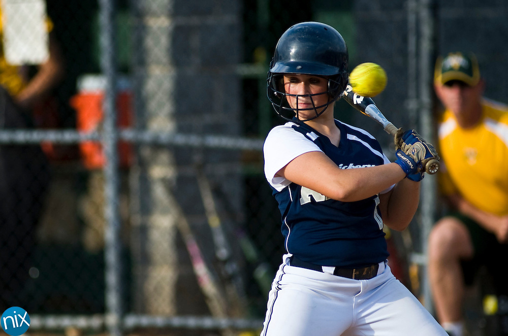 Hickory Ridge's Mary Hart gets out of the way of a high pitched ball against Central Cabarrus Tuesday evening at Central Cabarrus High School. Hickory Ridge won the game 7-1.  (Photo by James Nix)