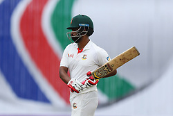 August 29, 2017 - Mirpur, Dhaka, Bangladesh - Bangladeshi cricketer Tamim Iqbal leaving the pitch after the dismassal  during the third day of the first Test cricket match between Bangladesh and Australia at the Sher-e-Bangla National Cricket Stadium in Dhaka on August 29, 2017. (Credit Image: © Ahmed Salahuddin/NurPhoto via ZUMA Press)