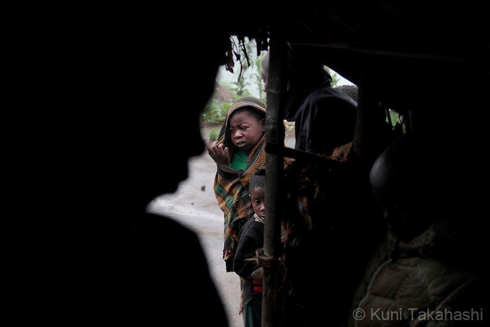 Children take shelter from rain at Mpati IDP camp, about 100 km northwest of Goma, DRC on April 23, 2010. The long war had involved 9 African nations and claimed an estimated three million lives as a result of fighting or disease and malnutrition..Photo by Kuni Takahashi