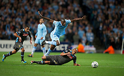 MANCHESTER, ENGLAND - Wednesday, September 14, 2011: Manchester City's Yaya Toure in action against SSC Napoli's Gokhan Inler during the UEFA Champions League Group A match at the City of Manchester Stadium. (Photo by Chris Brunskill/Propaganda)