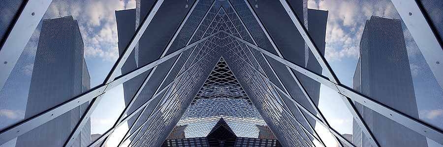 Skyscrapers are reflected in the glass walls of the Seattle Central Public Library in Seattle, Washington (mirrored).