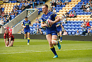 Ben Currie of Warrington Wolves races away to score his 2nd try of the match against Bradford Bulls during the Ladbrokes Challenge Cup match at the Halliwell Jones Stadium, Warrington<br /> Picture by Stephen Gaunt/Focus Images Ltd +447904 833202<br /> 21/04/2018