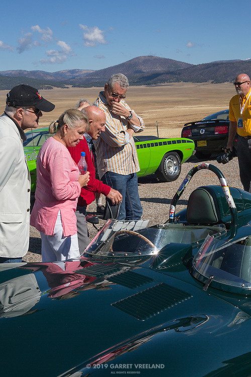 Sir Stirling and Lady Susan Moss, checking the Jaguar D-Type. On the 2012 Santa Fe Concorso High Mountain Tour.