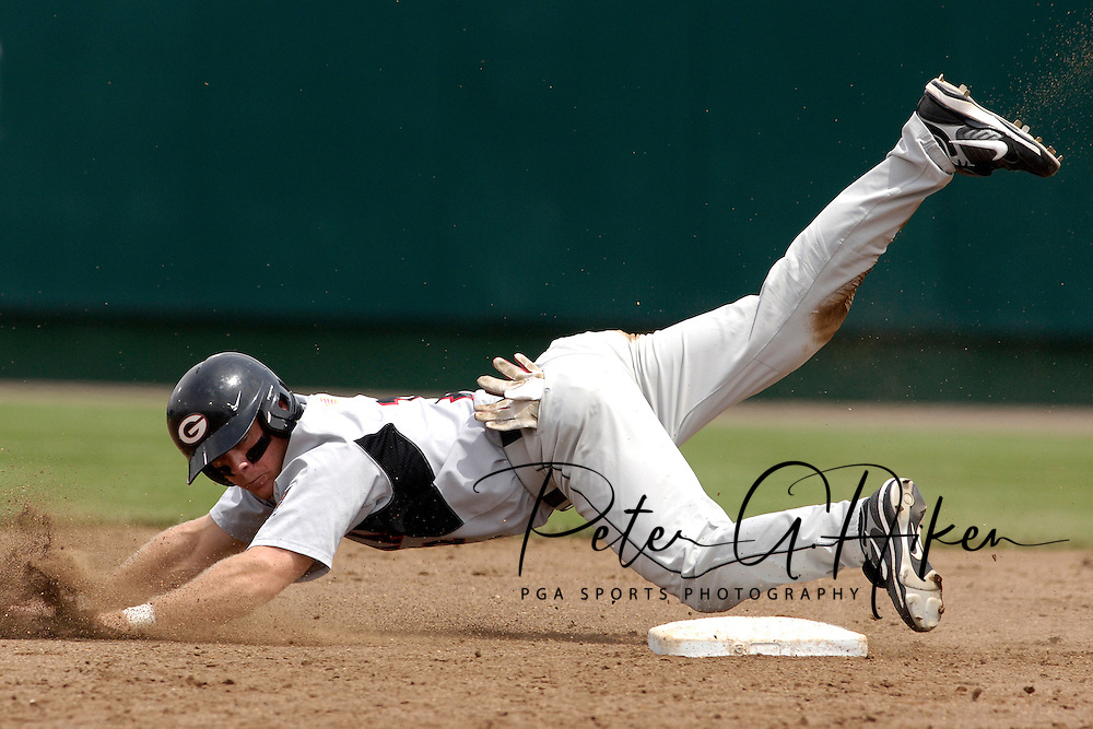 Georgia's Bobby Felmy tumbles over second base, after being taged out to end the top of the fourth inning against Rice University.  The Rice Owls defeated the Georgia Bulldogs 6-4 during second day action at the College World Series at Rosenblatt Stadium in Omaha, Nebraska, June 17, 2006.