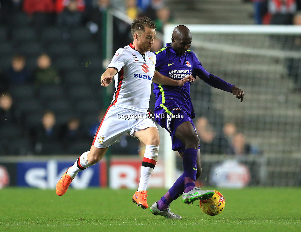 Milton Keynes Dons' Dean Bowditch (left) and Charlton Athletic's Alou Diarra battle for the ball.