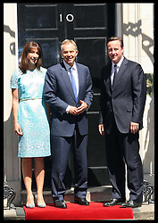 Prime Minister David Cameron and  wife Samantha greet Tony Blair  for a lunch with The Queen and Duke of Edinburgh,  and other former Prime Minister's at 10 Downing St.,London,  Tuesday, 24th July 2012.  Photo by: Stephen Lock / i-Images