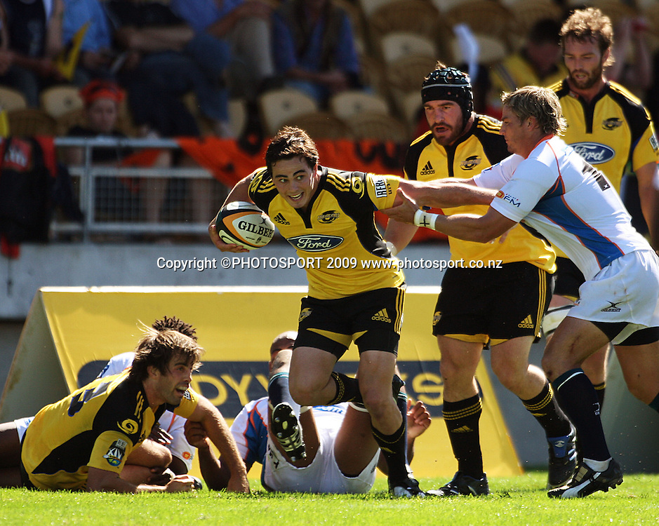 Zac Guildford tries to fend off Jaques-Louis Potgeiter after receiving a pass from the grounded Conrad Smith (left). Andrew Hore and Jason Eaton are in support.<br /> Super 14 rugby union match, Hurricanes v Cheetahs at Yarrows Stadium, New Plymouth, New Zealand. Saturday 7 March 2009. Photo: Dave Lintott/PHOTOSPORT