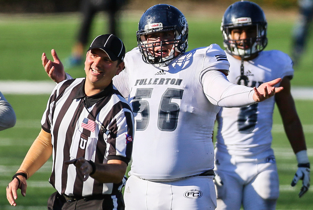 11/5/2016 - Fullerton Hornet offensive lineman Nathan Trent (56) protests a call made during the game against Orange Coast College - Costa Mesa, CA.<br /> <br /> &copy;2016 Jayme Spoolstra/Sports Shooter Academy