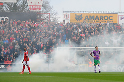 Bristol City fans set of smoke  - Photo mandatory by-line: Dougie Allward/JMP - Mobile: 07966 386802 - 15/11/14 - SPORT - Football - Swindon - The County Ground - Swindon Town v Bristol City - Sky Bet League One