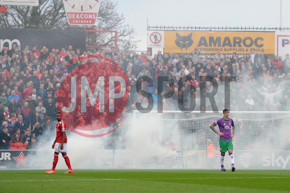 Bristol City fans set of smoke  - Photo mandatory by-line: Dougie Allward/JMP - Mobile: 07966 386802 - 15/11/14 - SPORT - Football - Swindon - The County Ground - Swindon Town v Bristol City - Sky Bet League One