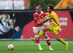 Bristol City's Aaron Wilbraham is challenged by Milton Keynes Dons' George Baldock - Photo mandatory by-line: Dougie Allward/JMP - Mobile: 07966 386802 - 27/09/2014 - SPORT - Football - Bristol - Ashton Gate - Bristol City v MK Dons - Sky Bet League One