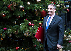 © Licensed to London News Pictures. 18/12/2017. London, UK. Secretary of State for International Trade Liam Fox leaves 10 Downing Street after a special Cabinet meeting. Photo credit: Rob Pinney/LNP