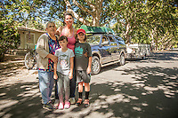 """We're ten minutes away from heading to Montana for a two week camping trip.""  -Mutt Lynch Winery owner Brenda Lynch with her kids Porter and Katie and their nanny  in front of her home in Calistoga.Calistoga"