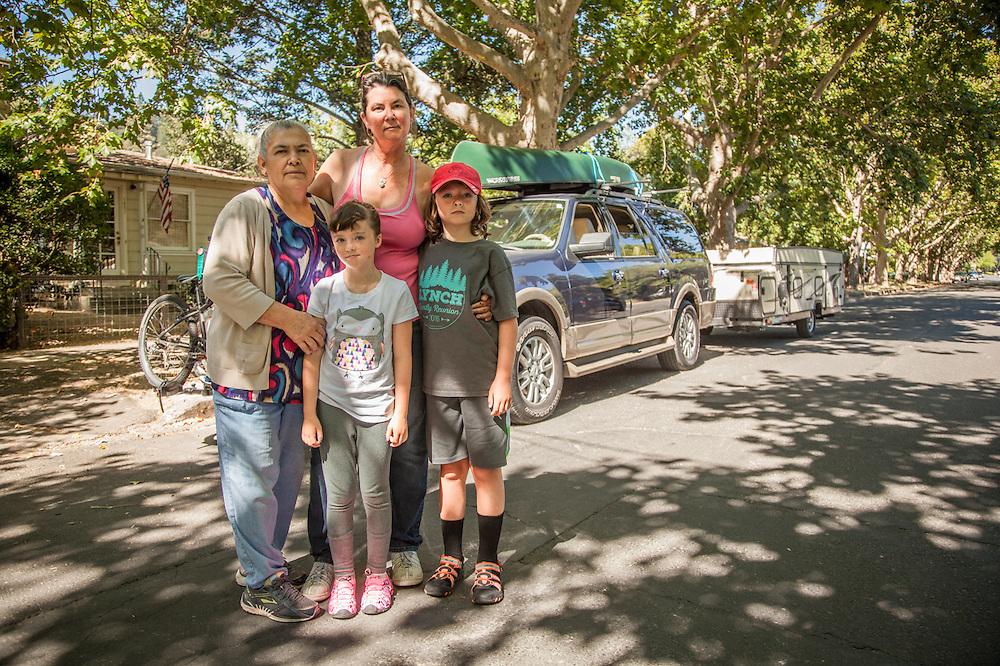 """""""We're ten minutes away from heading to Montana for a two week camping trip.""""  -Mutt Lynch Winery owner Brenda Lynch with her kids Porter and Katie and their nanny  in front of her home in Calistoga.Calistoga"""