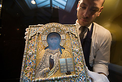 © licensed to London News Pictures. London, UK 23/11/2012. Icon of Christ Pantocrator by Ovchinnikov estimated to be sold for £180,000-250,000 by Sotheby's on 26 November 2012 in London. Photo credit: Tolga Akmen/LNP