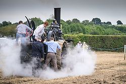 A vintage ploughing steam engine working at the Essex Country Show, Barleylands, Essex.