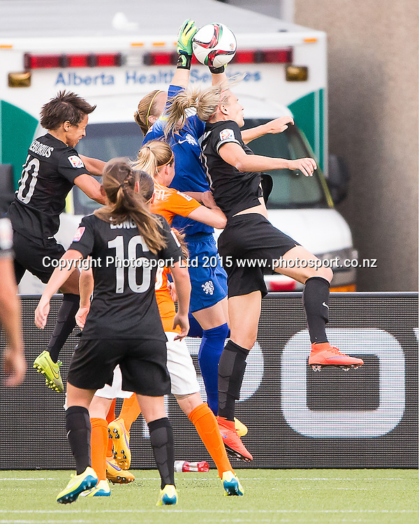 Hannah Wilkinson, Loes Geurts. Edmonton, Alberta, Canada, June 6, 2015.  The opening day of the Women's World Cup at Commonwealth Stadium.  New Zealand was defeated by Netherlands 1-0.