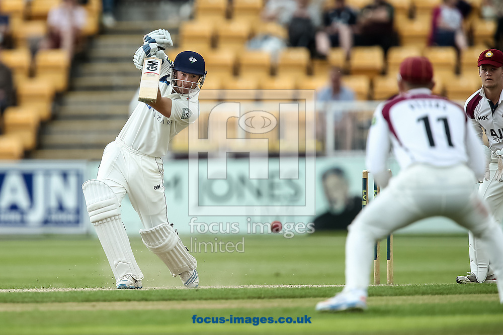 Adam Lyth of Yorkshire County Cricket Club (left) hits to the offside during the LV County Championship Div One match at the County Ground, Northampton, Northampton<br /> Picture by Andy Kearns/Focus Images Ltd 0781 864 4264<br /> 01/06/2014