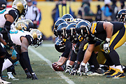 The Pittsburgh Steelers offensive line gets set at the line of scrimmage opposite the Jacksonville Jaguars defensive line during the NFL 2018 AFC Divisional playoff football game against the Jacksonville Jaguars, Sunday, Jan. 14, 2018 in Pittsburgh. The Jaguars won the game 45-42. (©Paul Anthony Spinelli)