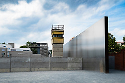 Reconstruction of former Berlin Wall death zone with watchtower at Berlin Wall memorial park at Bernauer Strasse in Berlin, Germany
