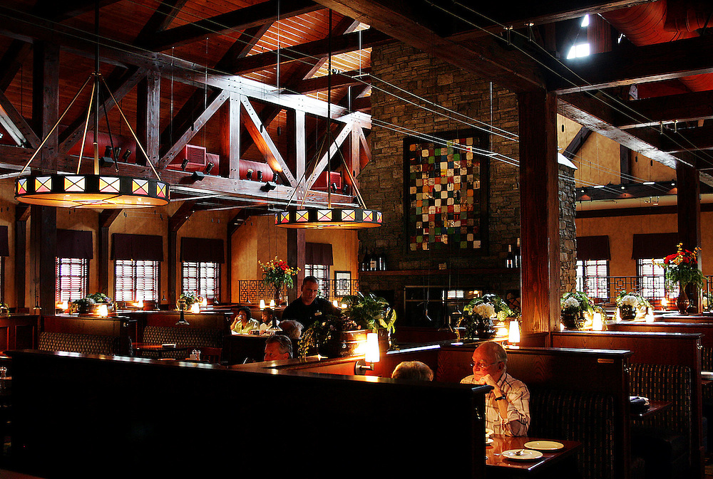 Heavy wooden beams & stone are featured inside the Village Tavern restaurant in Alpharetta.
