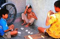 Boy friends playing cards in Hanoi, Vietnam, 1993