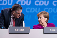 26 FEB 2018, BERLIN/GERMANY:<br /> Ulf Leisner (L), Stv. Bundesgeschaeftsfuehrer der CDU, und Angela Merkel (R), CDU, Budneskanzlerin, im Gespraech, CDU Bundesparteitag, Station Berlin<br /> IMAGE: 20180226-01-120<br /> KEYWORDS: Party Congress, Parteitag