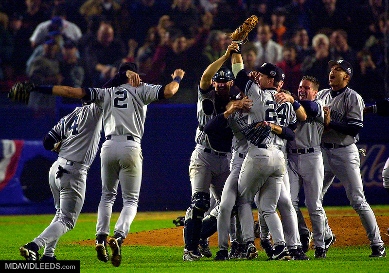 26 Oct 2000:  The New York Yankees celebrate their 4-2 win and World Series Championship over the New York Mets during Game 5 of the World Series at Shea Stadium in Flushing, New York.  Mandatory Credit: M David Leeds/ALLSPORT