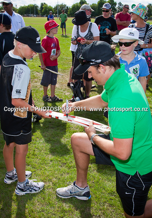 Shane Bond with young fans during the NCC Super Camp for Primary School players, an initiative by The National Bank to connect with the grass roots of cricket, hosted by Hamilton Star University Cricket Club, Waikato University, Hamilton, New Zealand, Wednesday 5 January 2011. Photo: Stephen Barker/PHOTOSPORT