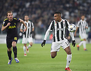 Alex Sandro of Juventus against Harry Kane of Tottenham during the Champions League Round of 16, leg 1 of 2 match between Juventus FC and Tottenham Hotspur at Juventus Stadium, Turin, Italy on 13 February 2018. Picture by Ahmad Morra