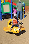 Keegan James, 3 of Newtown, Pennsylvania plays on a bumble bee after the dedication of Noah's Playground  Saturday November 14, 2015 in Newtown, Pennsylvania. Noah's Playground, a project 5 years in the making is named for Noah Cohen, the son of Newtown Township residents Natalie and Jason Cohen who died in 2010 at age two months of Sudden Infant Death Syndrome. (Photo by William Thomas Cain)