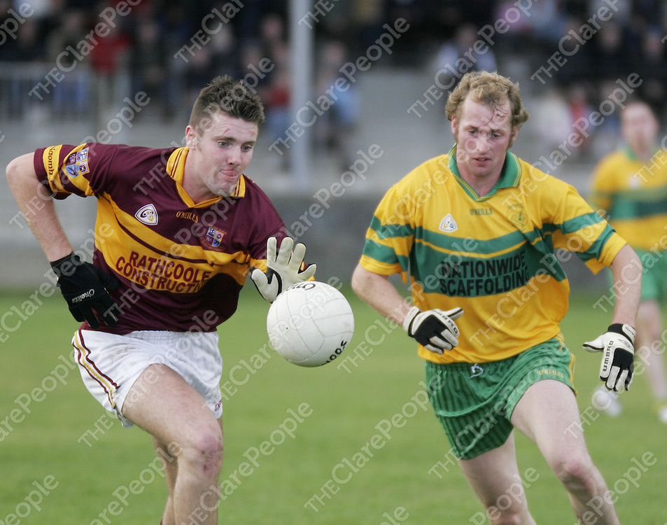 Miltown's Cathal Lafferty and O' Curry's Brendan Troy go for a 50/50 ball during their semi-final clash in Doonbeg on Sunday.<br />