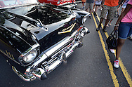 Pedestrians pass by a 1957 BelAir during the 6th Annual Doylestown at Dusk Car Show Saturday July 18, 2015 in Doylestown, Pennsylvania. (Photo by William Thomas Cain)