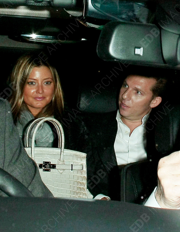 09.JANUARY.2012. LONDON<br /> <br /> HOLLY VALANCE AND FIANCE NICK CANDY LEAVING RESTAURANT 34 IN MAYFAIR, CENTRAL LONDON<br /> <br /> BYLINE: EDBIMAGEARCHIVE.COM<br /> <br /> *THIS IMAGE IS STRICTLY FOR UK NEWSPAPERS AND MAGAZINES ONLY*<br /> *FOR WORLD WIDE SALES AND WEB USE PLEASE CONTACT EDBIMAGEARCHIVE - 0208 954 5968*