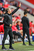 Forest Green Rovers manager Mark Cooper instructs his team during the EFL Cup match between Charlton Athletic and Forest Green Rovers at The Valley, London, England on 13 August 2019.