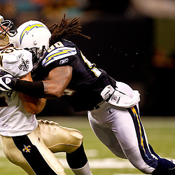 August 27, 2010; New Orleans, LA, USA; New Orleans Saints tight end Tyler Lorenzen (82) is hit by San Diego Chargers linebacker Antwan Applewhite (90) during the second half of a preseason game at the Louisiana Superdome. The New Orleans Saints defeated the San Diego Chargers 36-21. Mandatory Credit: Derick E. Hingle