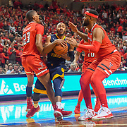 LUBBOCK, TX - JANUARY 13: Jevon Carter #2 of the West Virginia Mountaineers goes to the basket against Jarrett Culver #23 of the Texas Tech Red Raiders, Niem Stevenson #10 of the Texas Tech Red Raiders and Tommy Hamilton IV #0 of the Texas Tech Red Raiders during the game on January 13, 2018 at United Supermarket Arena in Lubbock, Texas. Texas Tech defeated West Virginia 72-71. (Photo by John Weast/Getty Images) *** Local Caption *** Jevon Carter;Jarrett Culver;Niem StevensonTommy Hamilton IV