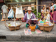 04 SEPTEMBER 2013 - BANGKOK, THAILAND: Street food vendors sell to people on Soi 22 Sukhmvit in Bangkok. There are hundreds of thousands of people employed in the street food industry in Thailand.       PHOTO BY JACK KURTZ