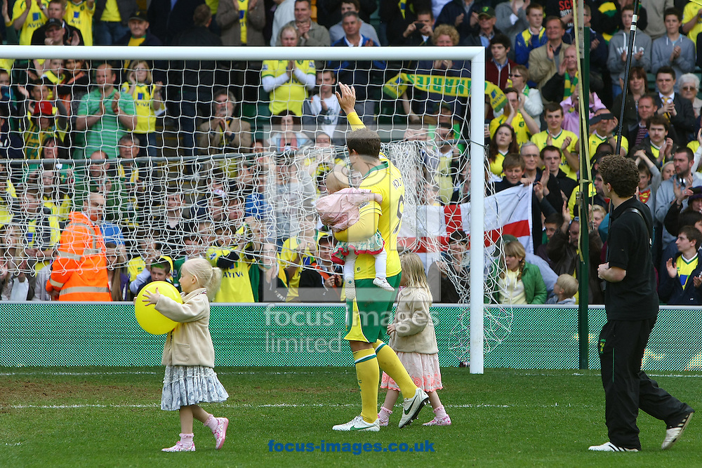 Picture by Paul Chesterton/Focus Images Ltd.  07904 640267.13/05/12.Grant Holt of Norwich and his children on the lap of appreciation after the Barclays Premier League match at Carrow Road Stadium, Norwich.
