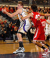 5 FEB. 2010 -- TOWN AND COUNTRY, MO. --  CBC High Schoo's Ryan Pierson (30) turns to shoot the ball past Chaminade Prep's Aaron Lombardo (42) during the game between CBC and Chaminade at CBC High School in Town and Country, Mo. Friday, Feb. 5, 2010. Photo (c) copyright by Sid Hastings.