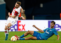 October 4, 2018 - Saint Petersburg, Russia - Aleksandr Erokhin (R) of FC Zenit Saint Petersburg and Jaromir Zmrhal of SK Slavia Prague vie for the ball during the Group C match of the UEFA Europa League between FC Zenit Saint Petersburg and SK Sparta Prague at Saint Petersburg Stadium on October 4, 2018 in Saint Petersburg, Russia. (Credit Image: © Mike Kireev/NurPhoto/ZUMA Press)