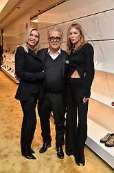 Left to right, KAREN SULLIVAN, GIUSEPPE ZANOTTI and ABBEY CLANCY  at the launch of the new Giusepe Zanotti store in Conduit Street, London on 26th October 2016.