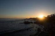 The suns rays shine brightly over the Pacific Grove coastline at sunrise. Monterey, CA 10.12.14