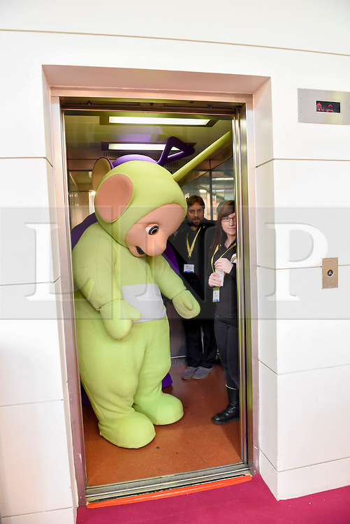 © Licensed to London News Pictures. 24/01/2016. London, UK. A Tellytubby character squeezes into a lift at the opening day of the Toy Fair 2017, taking place at Kensington Olympia.  The trade show brings together many of the leading toy manufacturers and distributors and offers a chance for buyers to see the latest toys in preparation for Christmas. Photo credit : Stephen Chung/LNP